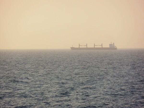 A bulk carrier in the Mediterranean sunset.