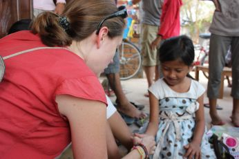 Playing thumb war with Lifatsima at a school we volunteered with in Cambodia