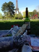Picnicking in front of the Eiffel Tower with wine and cheese, salad and matzo