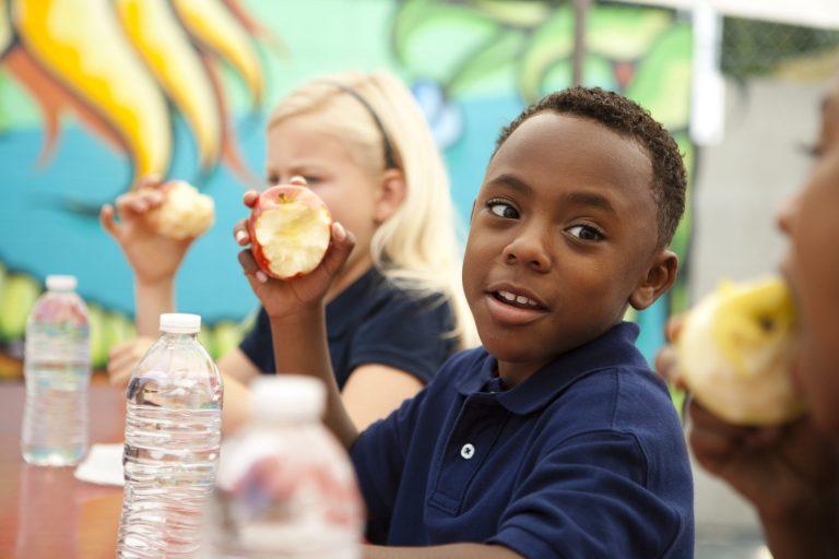 stock-photo-student-eating-apple