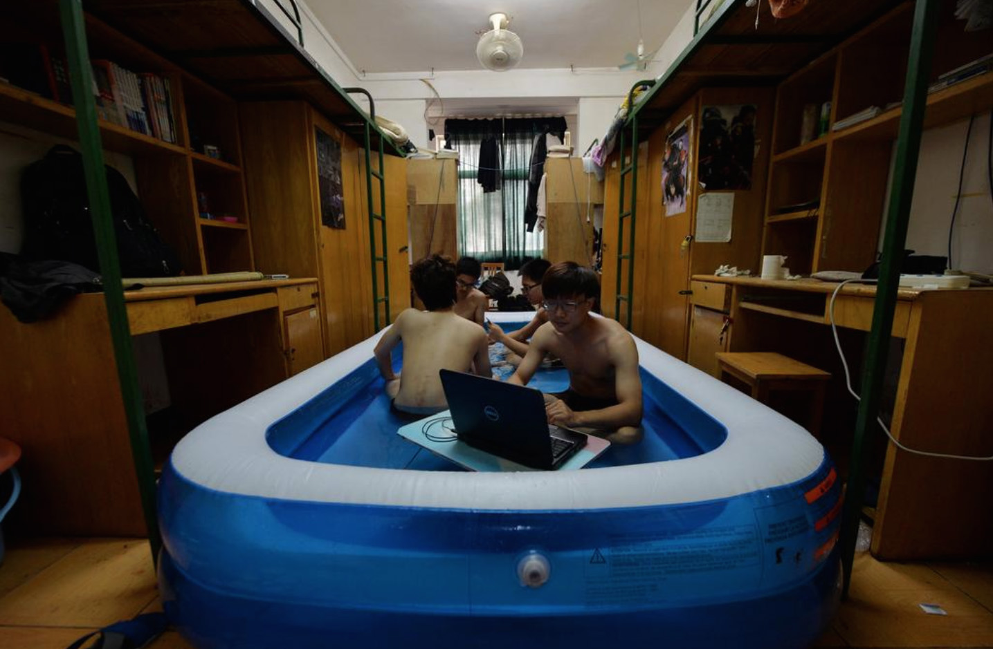 Wuhan Students Escape Dog Days Of Summer With Inflatable