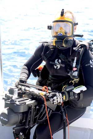 navigator scanner with diver on boat in palau on bentprop expedition