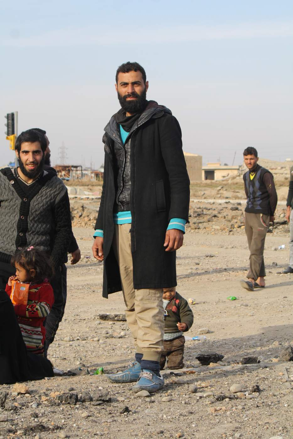Iraqi soldiers say they deploy locals to units receiving displaced families to distinguish IS militants trying to escape from regular civilians that happen to be dressed in IS styles. (H. Murdock\/VOA) Jan. 14, 2017