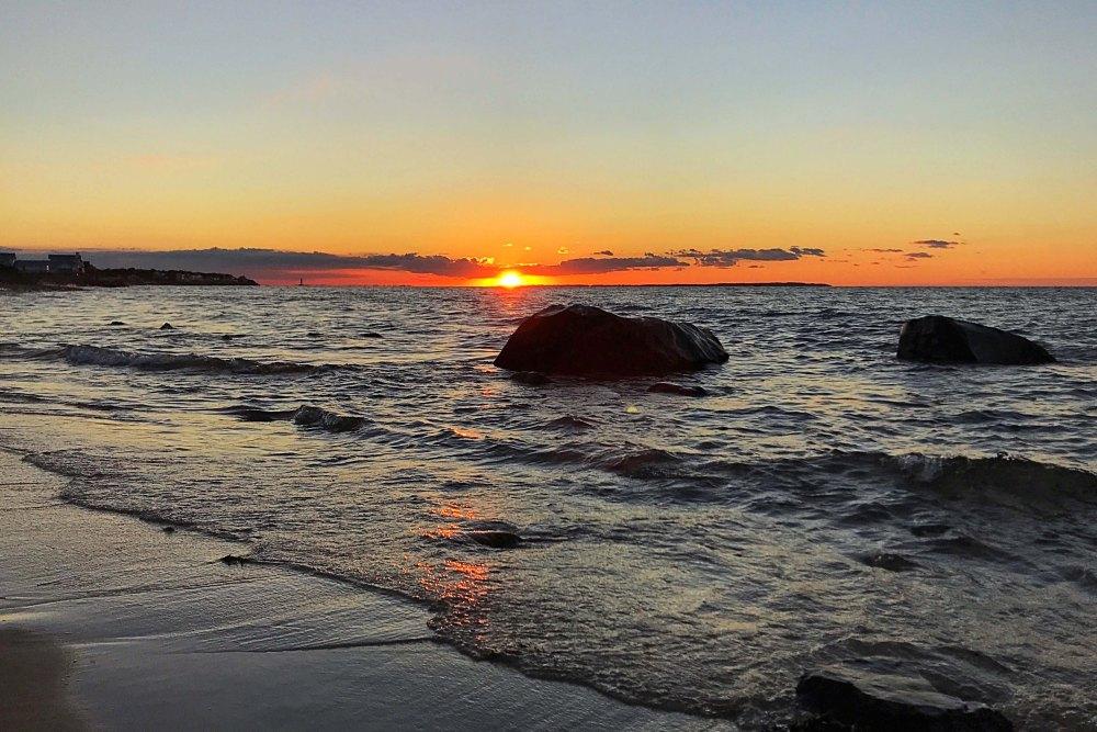 Picturesque sunset overlooking the sea at Sunset Beach in Montauk, New York