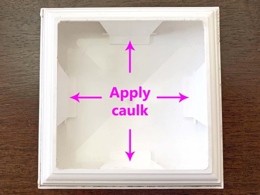 Diagram showing where to add caulk to a post cap