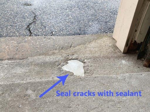 Hole in a garage floor sealed with caulk