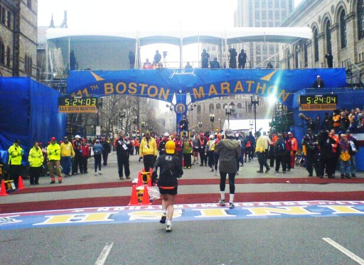 Runners approaching the iconic finish line of the Boston marathon