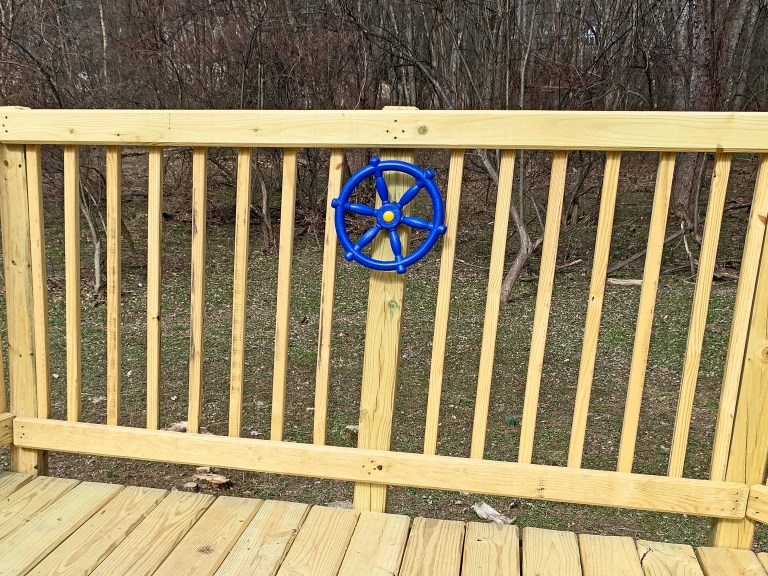 Blue pirate ship wheel on a playground