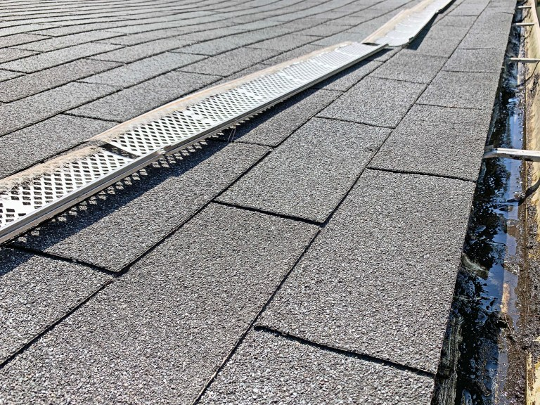 Gutter guards in a line on a roof
