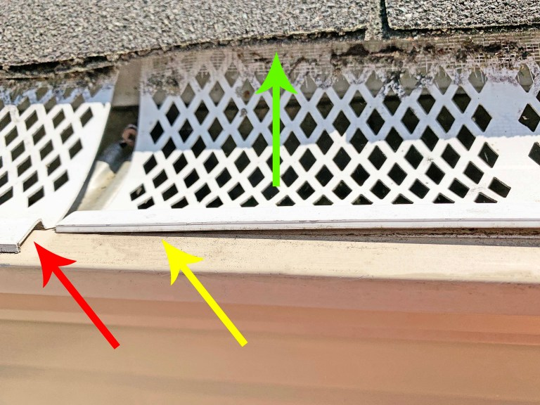 Snap-in gutter guards installed on a gutter