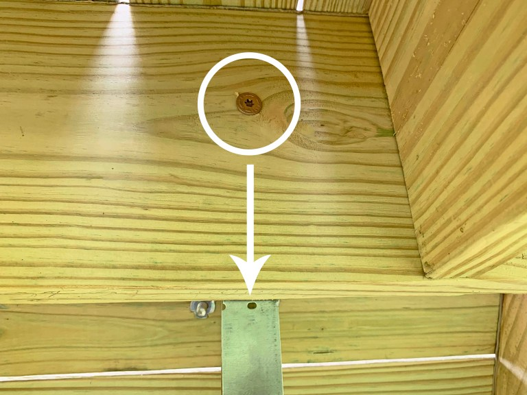 Timber screw fastening a joist to a playground