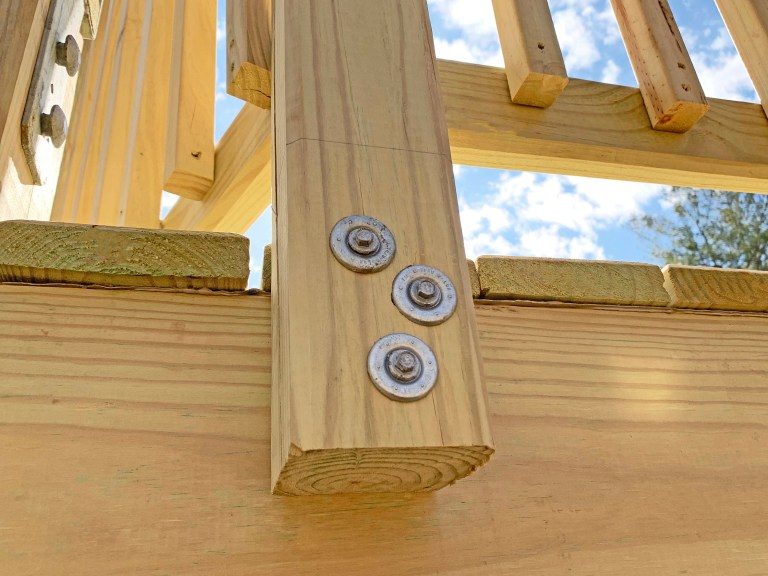 FastenMaster ThruLOK screw bolts secure the handrails to the playground