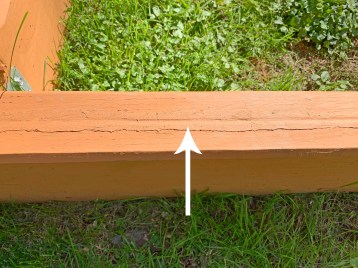 wood caulk, stained, on a playground