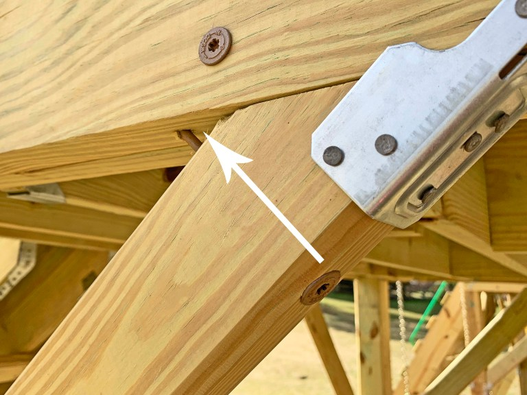 8 inch timber screws further secure diagonal knee bracing to a playground