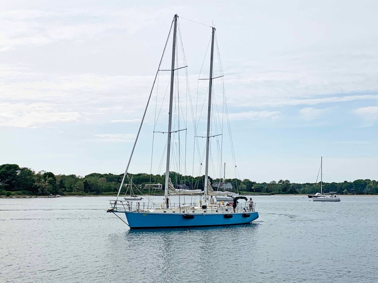 Blue sailboat in water