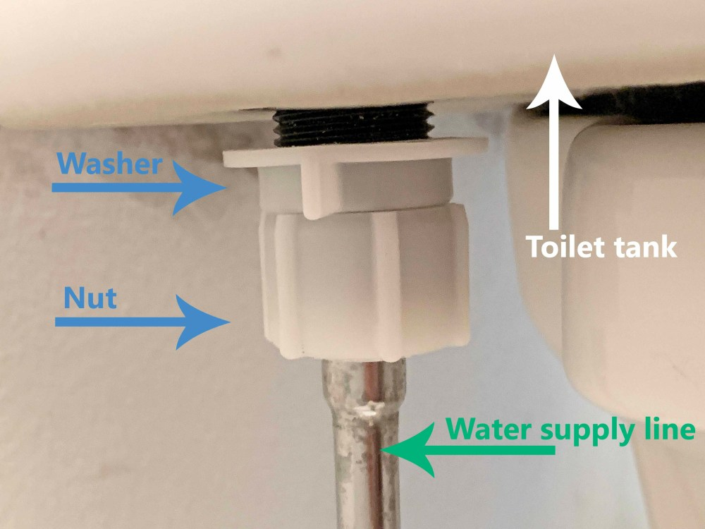 white toilet tank with water supply line washer and nut