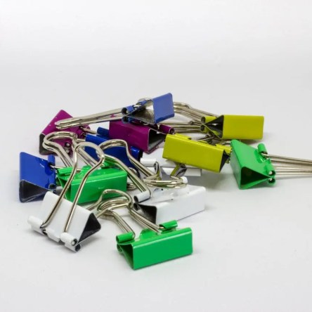 A pile of small, colourful bulldog clips
