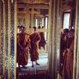 Monks gathered around Buddha's footprint.