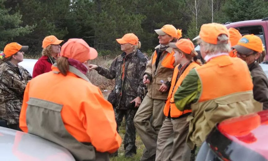 A group of women plan a days hunt.