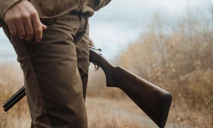Dr Ben Jones hols a shotgun while grouse hunting.