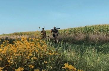 Dove hunters walking into a field.
