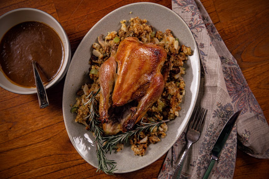 Roasted pheasant with cornbread stuffing and gravy