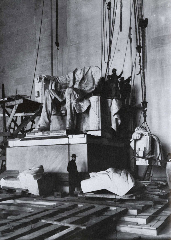 Photographer unknown. Installation of the statue of Abraham Lincoln in the Lincoln Memorial, Washington, DC. 1920. Records of the Office of Public Buildings and Public Parks of the National Capital (42-M-J-1).