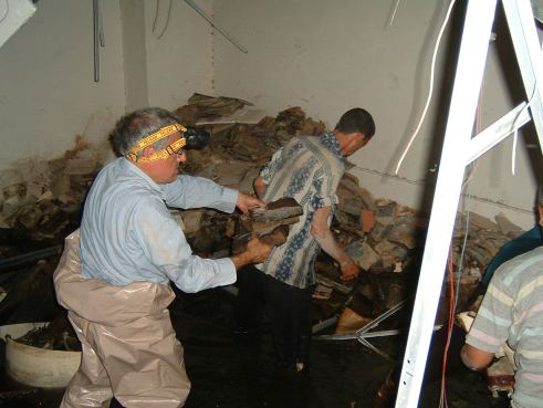 Materials being rescued in the flooded basement.