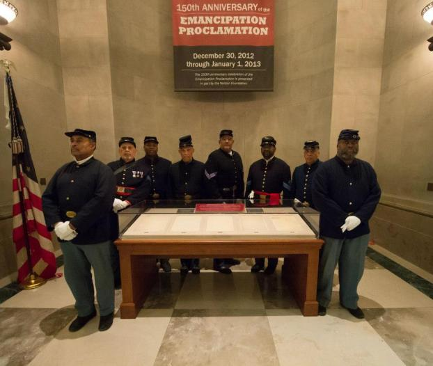 An honor guard of reenactors (B Company, 54th Massachusetts Volunteer Infantry Regiment, US Colored Troops) stands watch over the Emancipation Proclamation during the special display on January 1, 2013 (Photo by Charles Fazio)