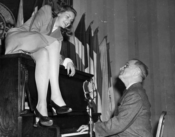 Lauren Bacall on Piano with Vice President Harry S. Truman, February 10, 1945. (Harry S. Truman Library and Museum)