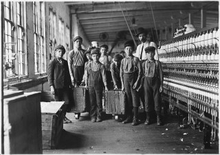 Some of the doffers and the Supt. Ten small boys and girls about this size out of a force of 40 employees. Catawba Cotton Mill. Newton, N.C., 12/21/1908, (National Archives Identifier 523141)