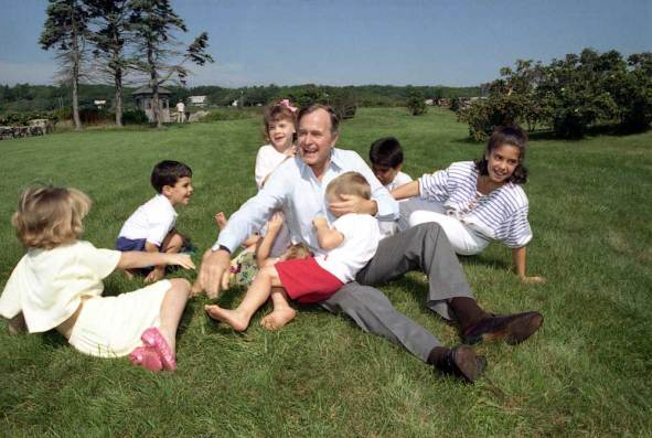 Vice President George Bush plays with his grandchildren at Walker's Point, Kennebunkport, Maine. 8/6/88.