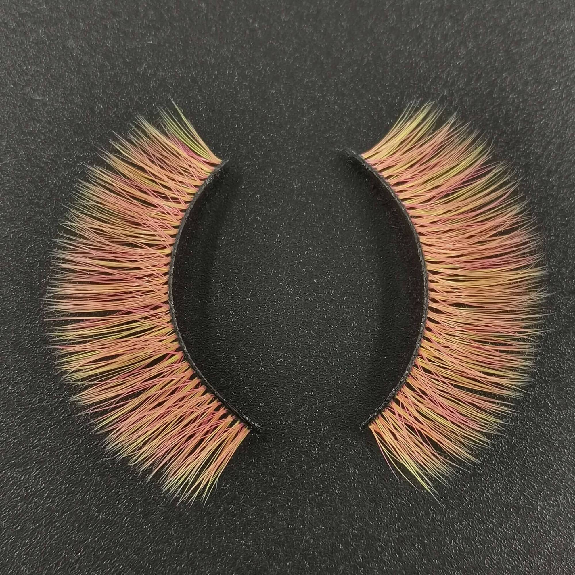 A pair of colored eyelashes for your eye shape and its color is orange with yellow tips. Trust me, ProluxuryLashes brand is the best eyelash supplier