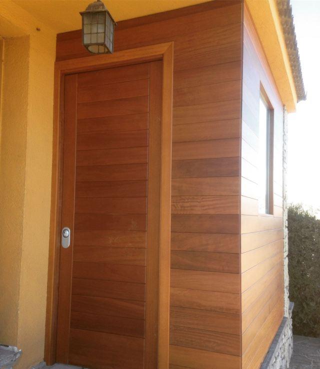 Promida entrada revestiment fusta