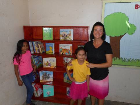 Promise Home team gives the small school in our village a library.