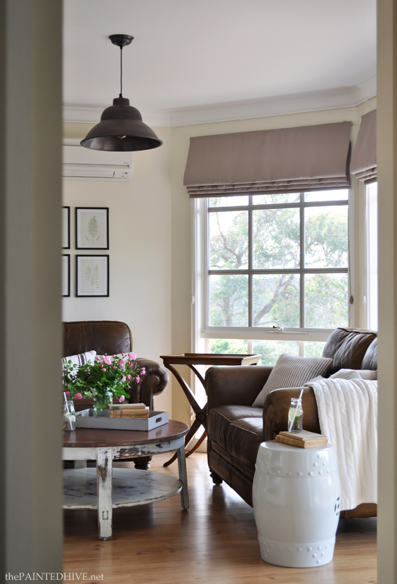 Cottage Country Living Room with Brown Leather Sofas