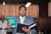 irfaan ali of babaa with his Koran