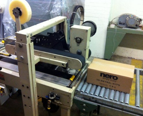 Software master cartons taped automatically.