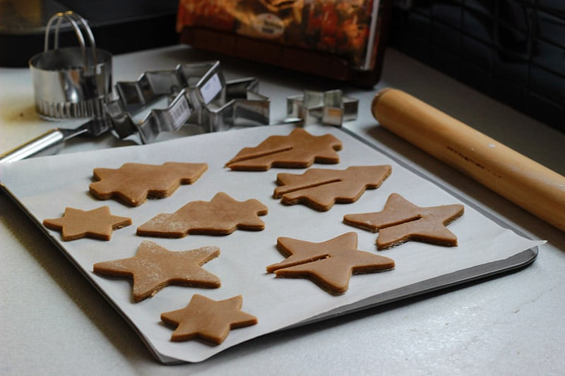 gingerbread biscuits on lined baking tray