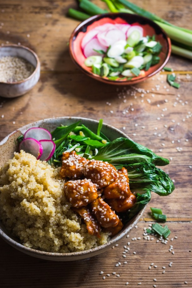 sesame seed chicken with quinoa and asian green vegetables