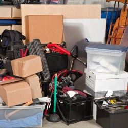 tenant's hoarding issue filling up items in a garage at rental property