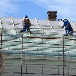 Roofers Installing New Roofing System With Extended Commercial Roof Life