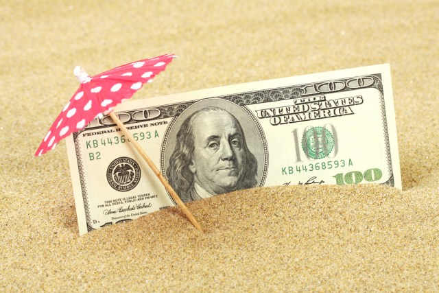 American One Hundred Dollar Bill In The Sand Under Umbrella For How Much Do Property Managers Make Blog