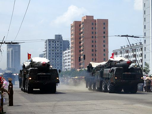 Colored photograph of 2 ballistic missiles on a wide road with tall buildings in background. Is Kim Jong-Un in bible prophecy?