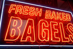 """A colored photograph of a Neon Sign in red with white-outlined lettering,saying """"Fresh Baked Bagels"""". Is the Rapture a good thing?"""