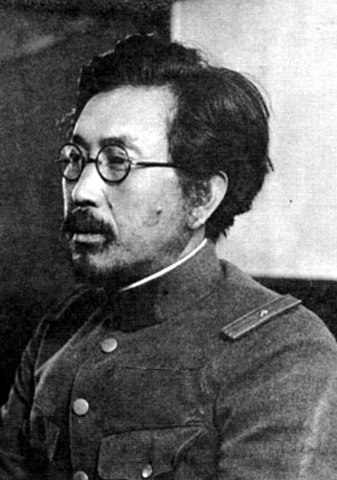 Black and white photograph of Japanese man with glasses in World War 2 uniform. Prophetic Pestilence.