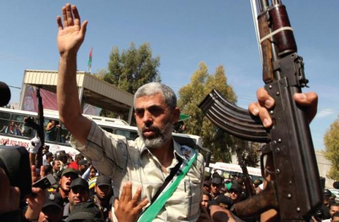 Hamas terrorist with hand raised