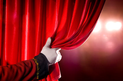 playwriting courses: hand parting stage curtain