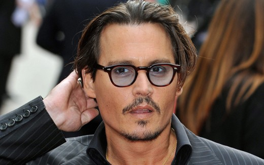 Johnny Depp wearing MOSCOT LEMTOSH