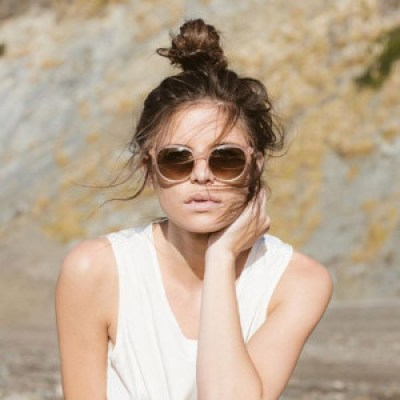 female wearing RAEN / NORIE color* Petal - ① -